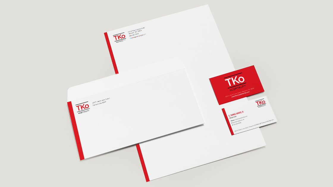 Design of TKo Hospitality business card, letterhead, and mailing envelope.